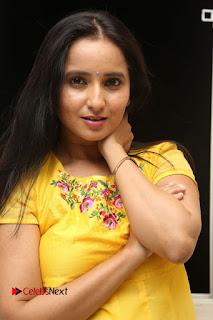 Actress Ishika Singh Pictures in Yellow Dress at Kobbari Matta Teaser Launch  0009.JPG