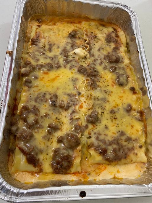 Delicious cheesy and meaty baked lasagna from House of Lasagna
