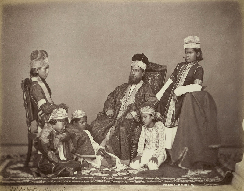 Studio portrait of a Mogul Father with his Children at Delhi, taken by Shepherd and Robertson - c1860's