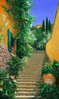 calle-de-escaleras-con-flores-al-cuadros