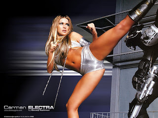 Carmen Electra Kicking Out To Someone In Silver Color Top And Short
