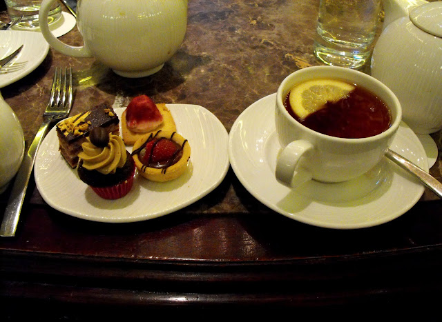 four little cakes and English Breakfast tea