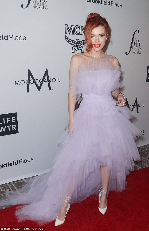 Bella Thorne oozes old Hollywood glamour in flowy purple tulle gown at Daily Front Row Awards