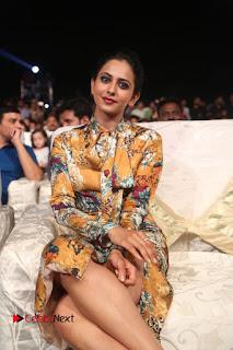 Actress Rakul Preet Singh Stills in Short Dress at Dhruva Pre Release Function  0097.JPG
