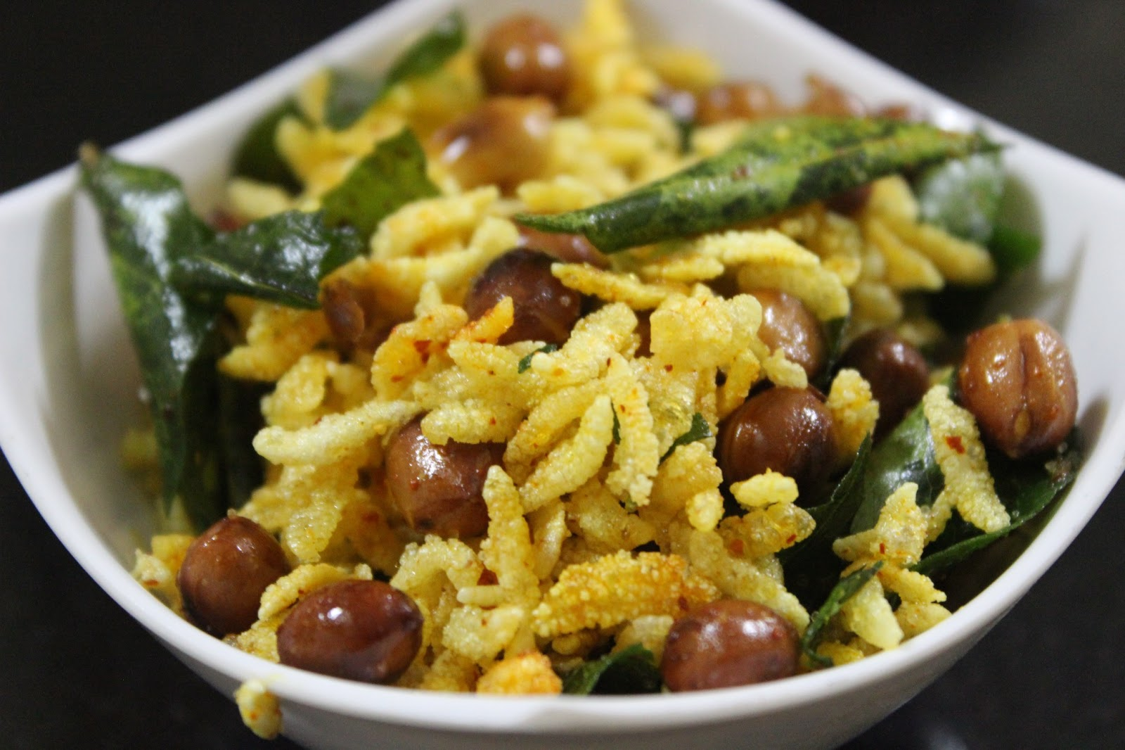 Poha/Flattened rice deep fried and flavoured with spices and peanuts