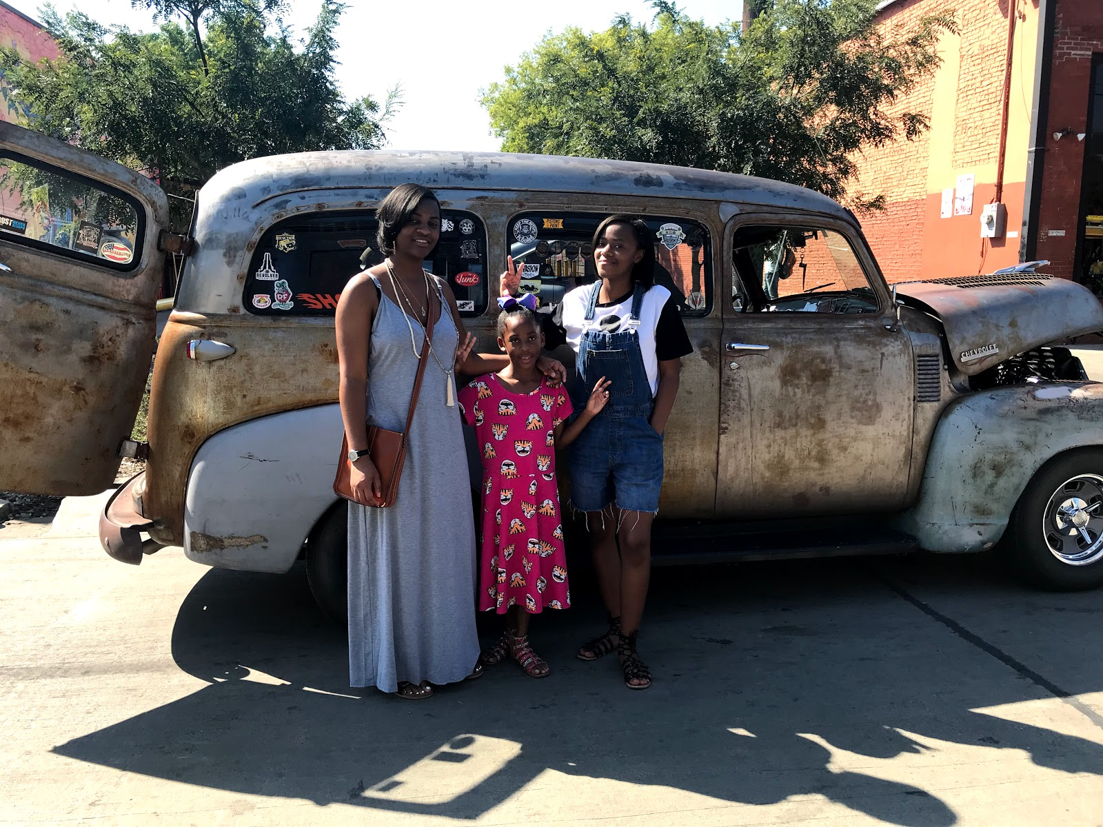 Image: Family posing in front of vintage truck at the Dallas Car Show in Deep Ellum