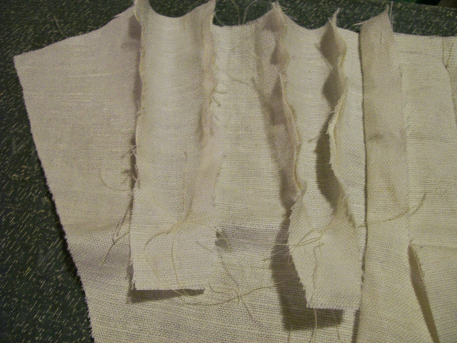Gores stitched into outer layer of stays.