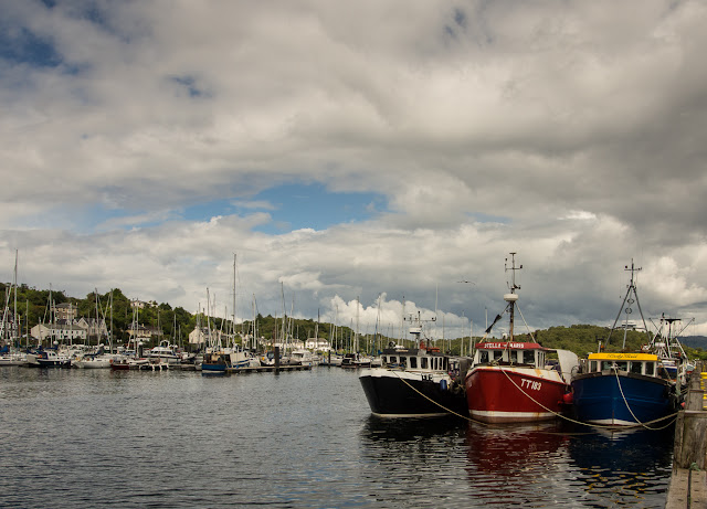 Photo of colourful fishing boats at Tarbert