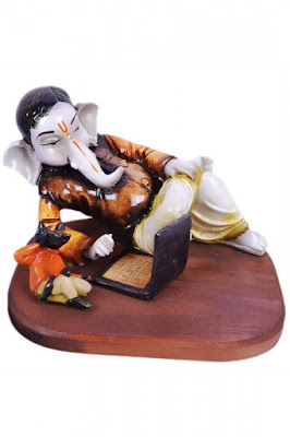 ganesha-doing-business-on-laptop