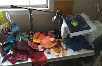 A mess - happy to put away the fabrics to FMQ
