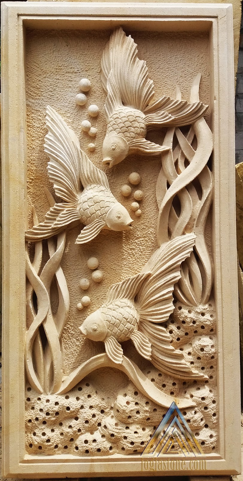 relief ikan hias kerajinan ukir batu alam paras jogja