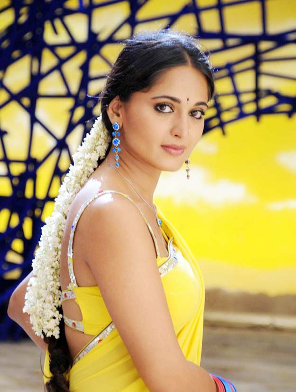Anushka Navel Show Photos In Yellow Saree