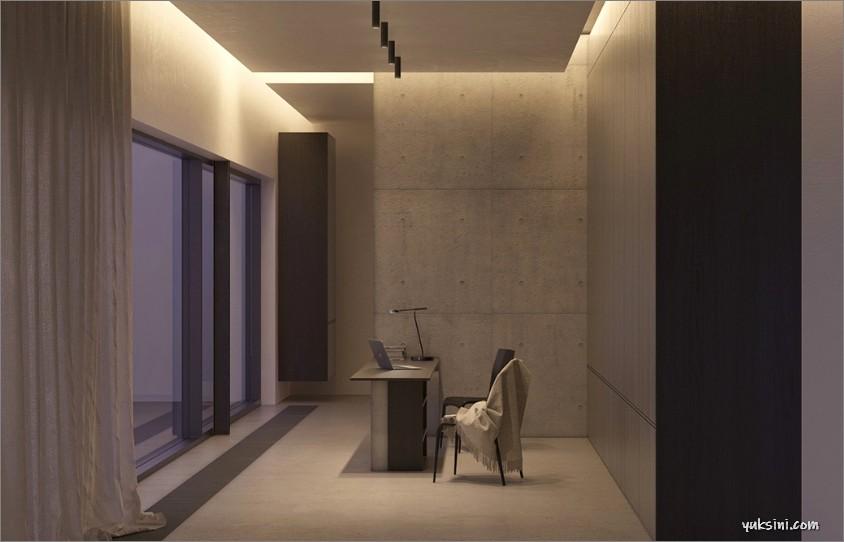 Desain ruang kerja minimalis modern dengan penerangan dramatis