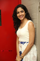 Actress Ritu Varma Stills in White Floral Short Dress at Kesava Movie Success Meet .COM 0104.JPG