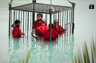 ISIS militants murdered 5 men by drowning them in a cage