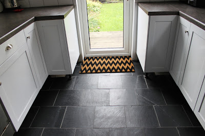 Take a look at our kitchen floor after laying slate tiles with underfloor heating
