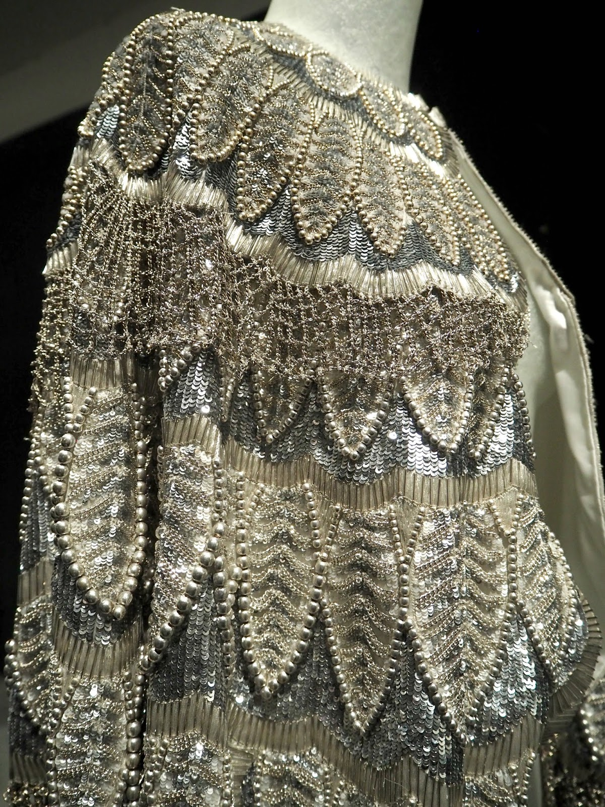 burberry cape pearls and feathers
