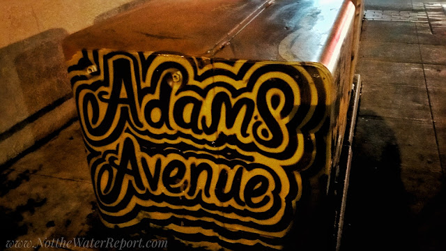"""Adams Avenue"" spray painted in an electrical Box"