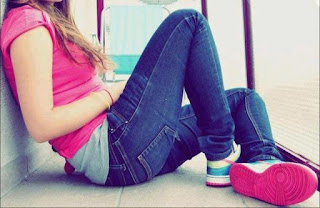 young-teen-girl-in-jeans-pink-tops-sitting-alone-love-thoughts-image.jpg