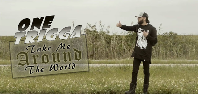 Screen Capture From One Trigga Video - Take Me Around The World - (with additional text added to it)