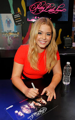 Actress Sasha Pieterse wearing a red dress