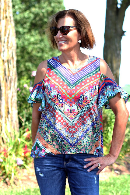 McCall's 7510 cold shoulder top made from a Mood Fabric's print