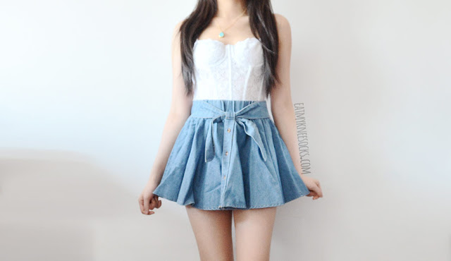A cute summer outfit featuring the turquoise blue druzy necklace from ShopWithElla, a white lace corset bustier top from Nasty Gal, and an Asian fashion-inspired tie-waist button=front denim skater skirt.