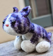 http://www.ravelry.com/patterns/library/maru-kitty-plush-toy