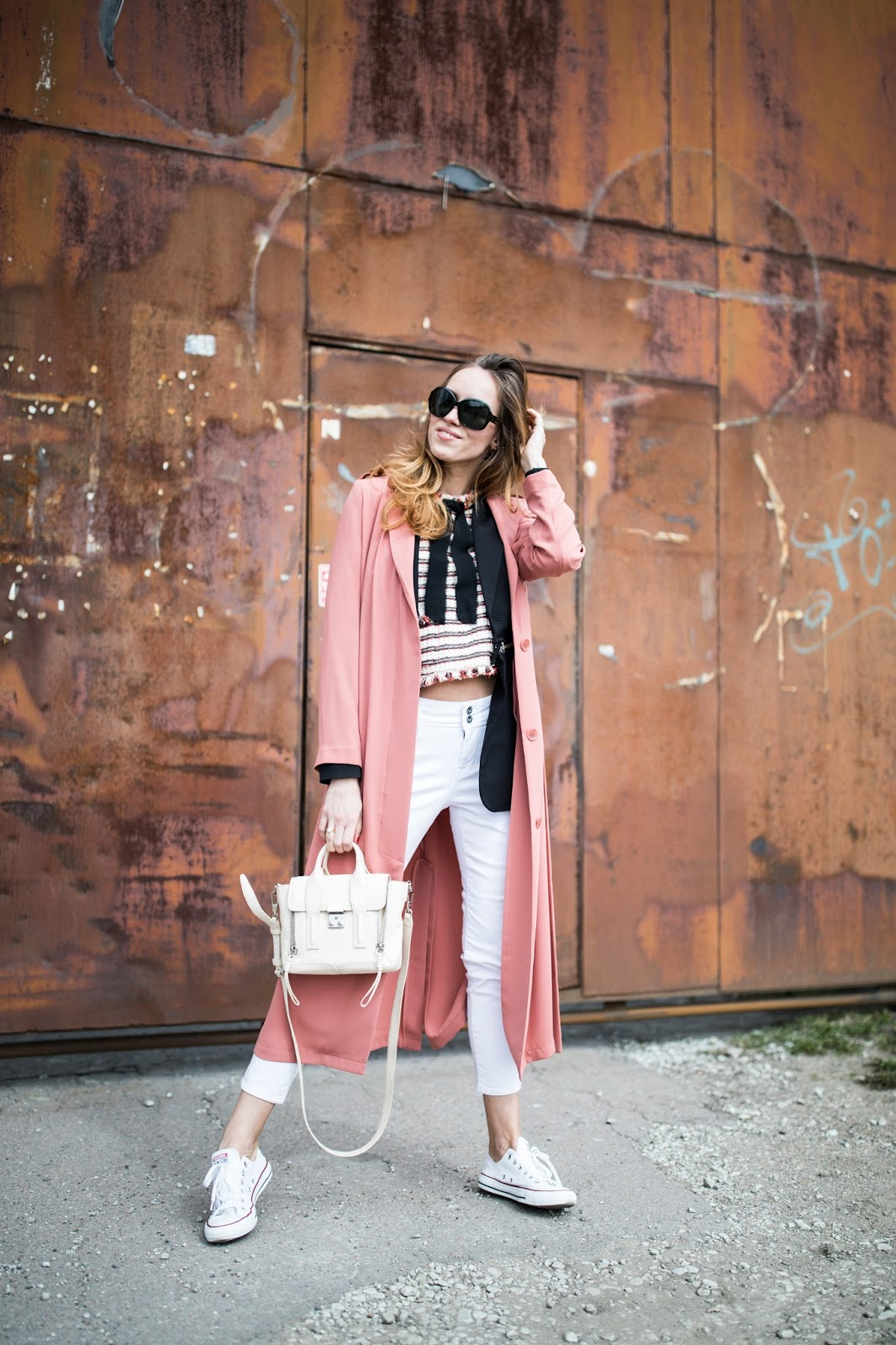 pink duster coat white jeans outfit