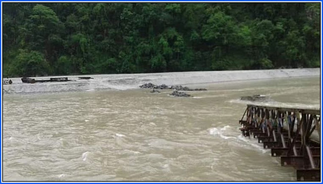 Overflowing river submerges newly-built bridge in Dzongu North Sikkim