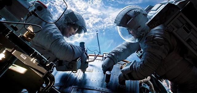 Sandra Bullock si George Clooney in Gravity
