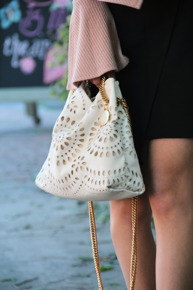 stella mccartney noma eyelet vegan leather ivory bucket bag gold chain lace