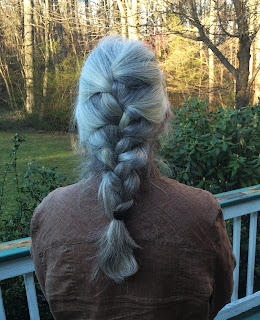 Long gray hair in a french braid