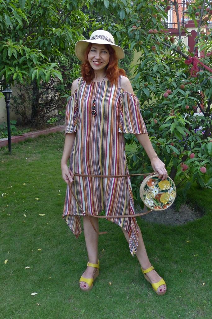 stripy open shoulder summer dress with paper hat