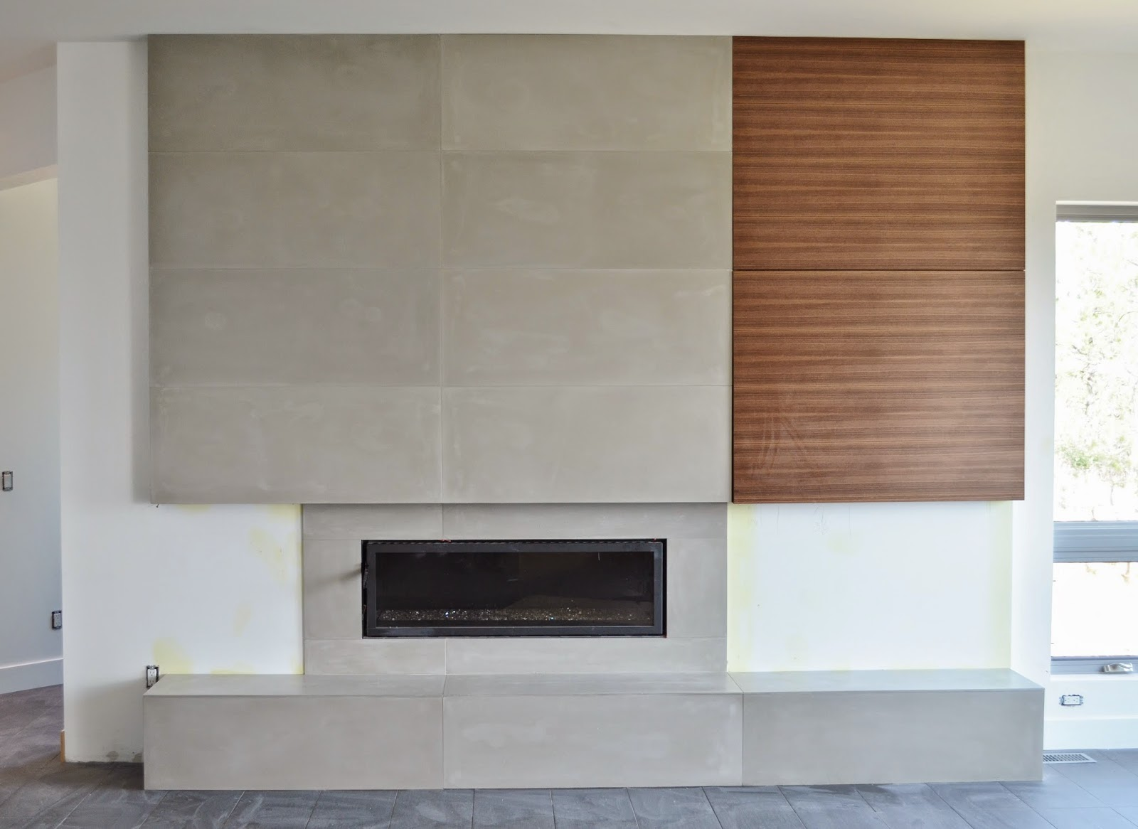 Contemporary Concrete Fireplace With Flush Wood Grain Cabinetry Large Format Tiles Created By Mode