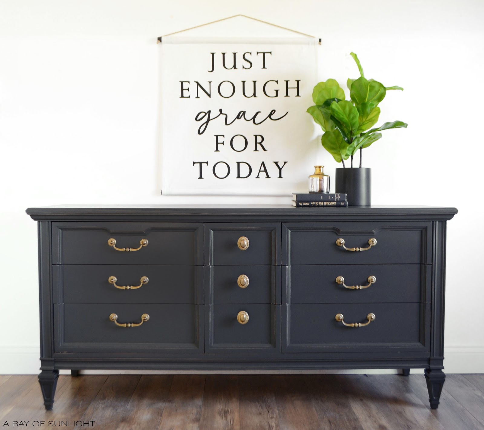 This vintage modern dresser got a complete makeover. From grey chalk paint, updated gold hardware, and freshly renewed drawers. I love how this deep grey finish is perfect for any home decor style. From farmhouse, to modern, to eclectic, and more! #farmhousedecor #furnituremakeover #furnituretransformation #paintedfurniture #chalkpaintedfurniture #modernfarmhouse #mcmfurniture #neutralfurniture #howtopaintfurniture