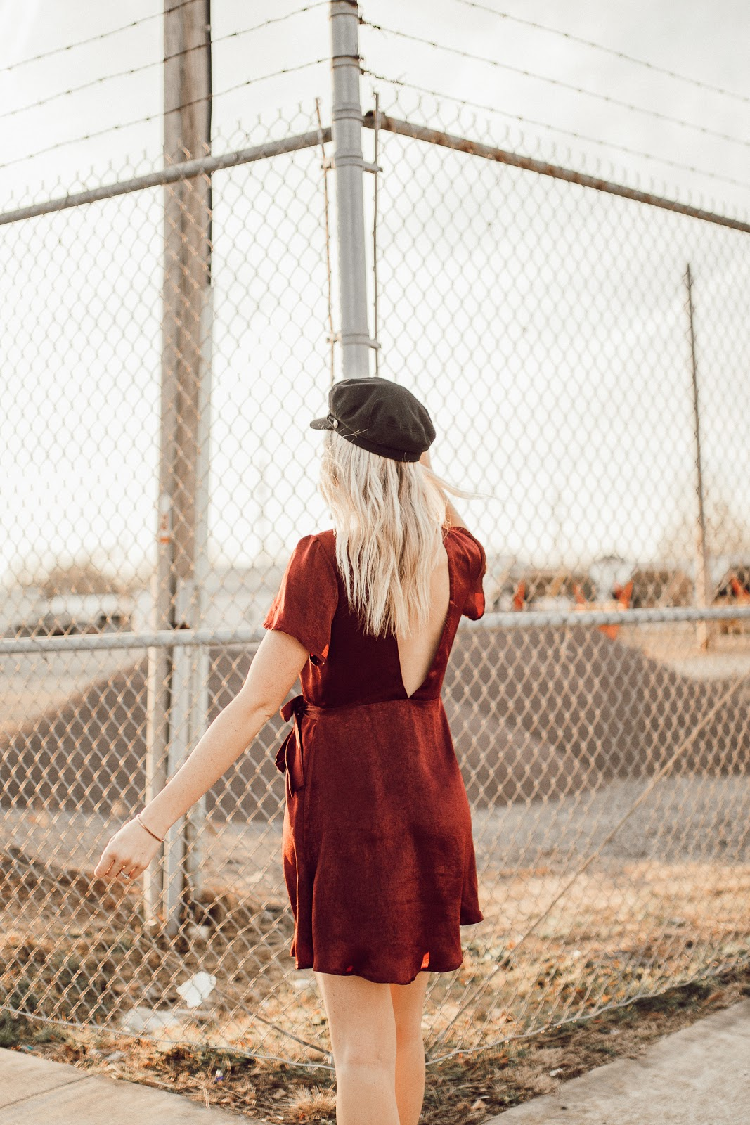 low back dress with a hat