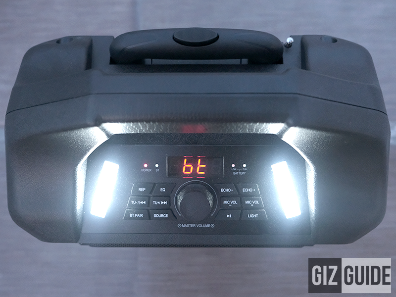 Extendable handle, indicator lights, control buttons, volume dial and LED lights