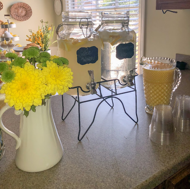 Yellow and White baby girl baby shower decoration ideas. You are my sunshine baby shower theme tips. Food and drinks. Lemon cupcakes. Fruit and yogurt parfait. Baby shower brunch