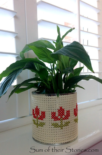 cross stitch planter from an old tin