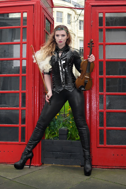 red phonebox violin black outfit