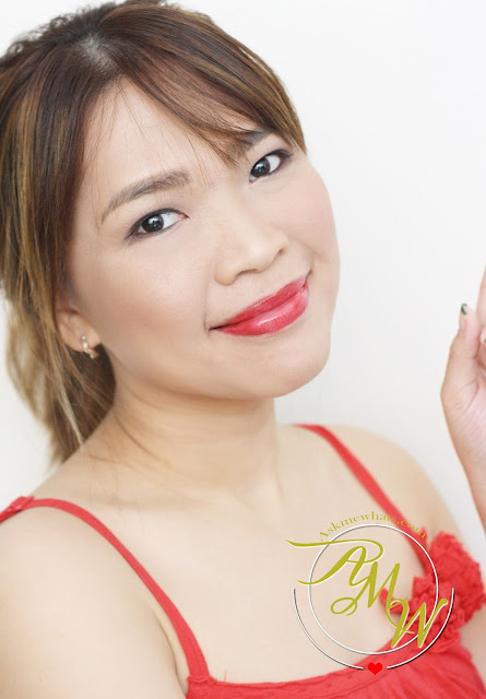 a photo of Nikki Tiu AskMeWhats wearing Celeteque Ultra-Nourishing Lip Lacquers Velvet Red