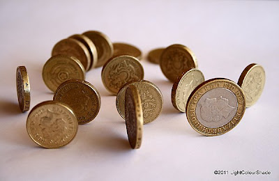 Money. Rolling pound coins
