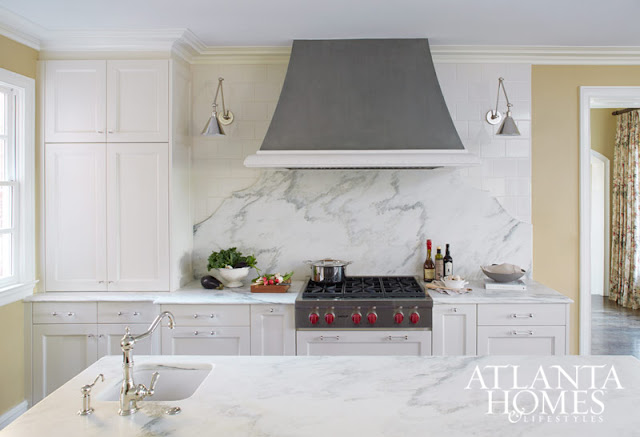 Magnificent white kitchen with marble slab statement wall and island