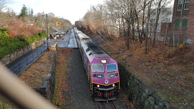 MBTA commuter train leaving Franklin/Dean Station headed to Forge Park