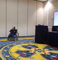Vilissa in wheelchair, giving presentation