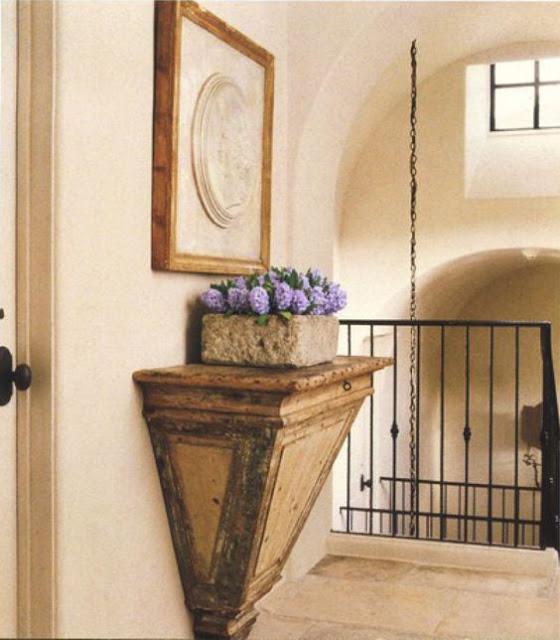 Antique shelf in hallway in Eleanor Cummings designed home