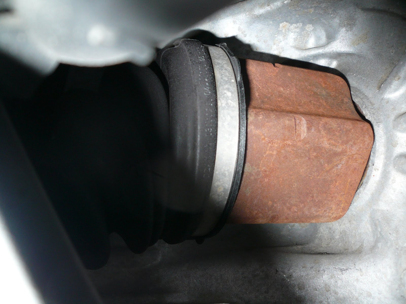 VW Passat Repair: How to Replace The CV Joint Boot on a 2006