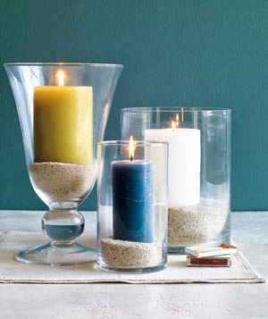 candles in cylinder vases with sand