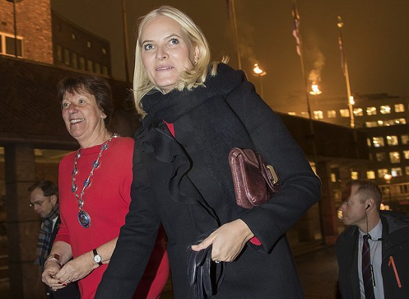 Crown Princess Mette-Marit wore Red valentino Ruffle Coat and Dolce and Gabbana Contrast stitch cady dress